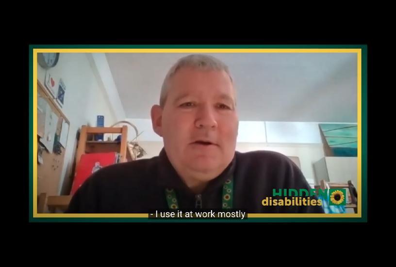 Matthew Tinsley speaks into his laptop wearing a Sunflower lanyard