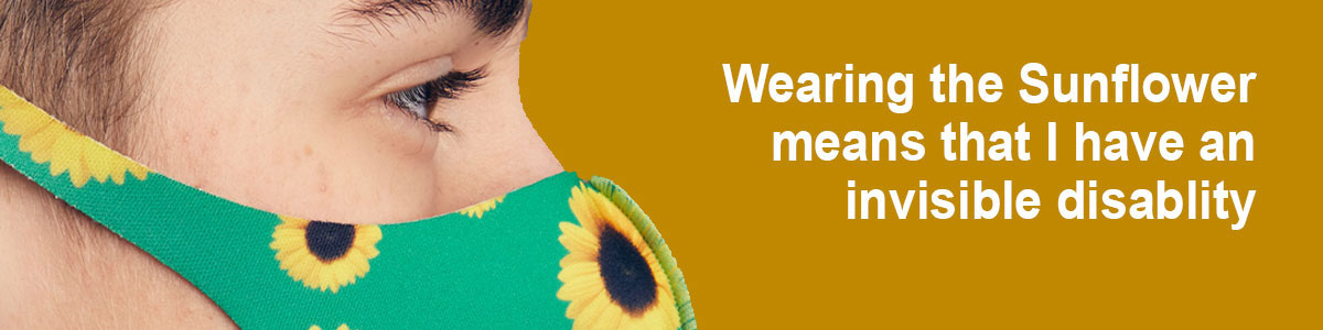 Person wearing Sunflower mask with text 'Wearing the Sunflower means that I have an invisible disability'