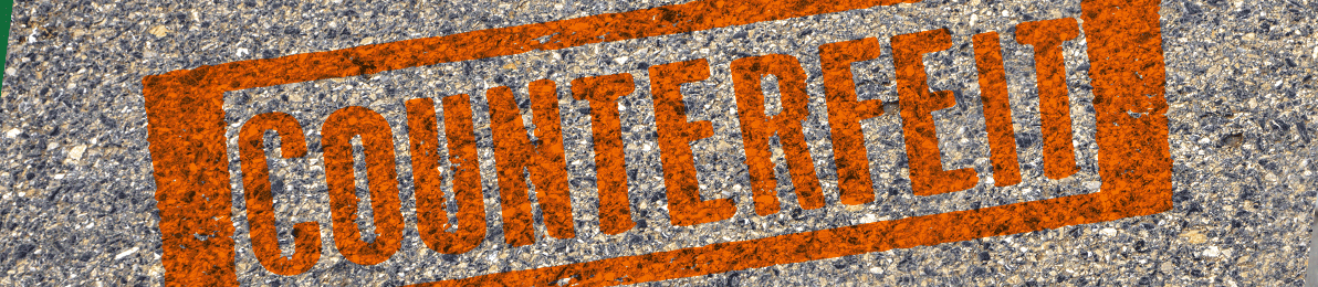 Text saying counterfeit on a pavement background