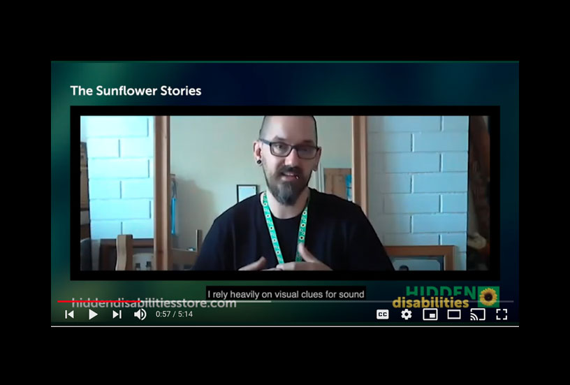 A capture of Daniel Watts during his video interview. Dan wears his Sunflower lanyard.